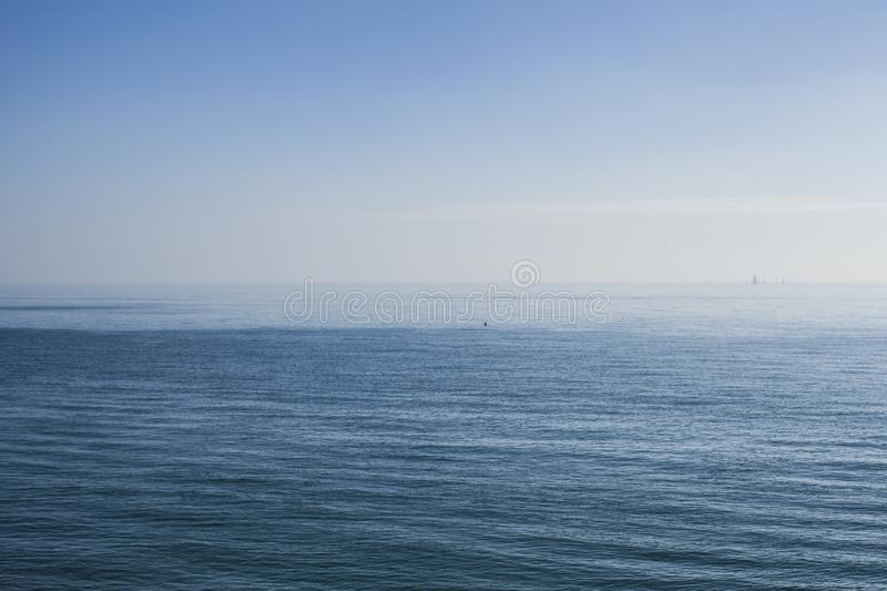 Eastbourne, England, the UK - blue seas and skies. This image shows a blue seas from a pier in Eastbourne, England. It was taken on a sunny day in October 2018 royalty free stock images