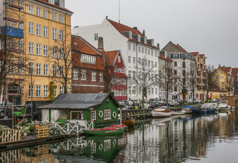 A canal and some colorful buildings in Copenhagen, Denmark. royalty free stock images