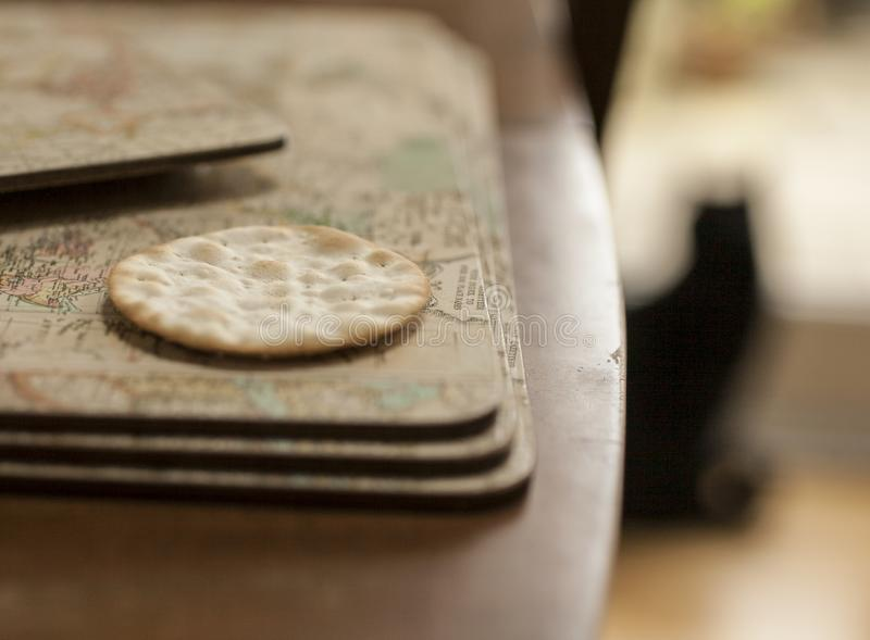 A close-up of a biscuit - an out-of-focus cat. This image shows a close-up of a biscuits with some bright surroundings. There`s an outline of a cat figure in royalty free stock image