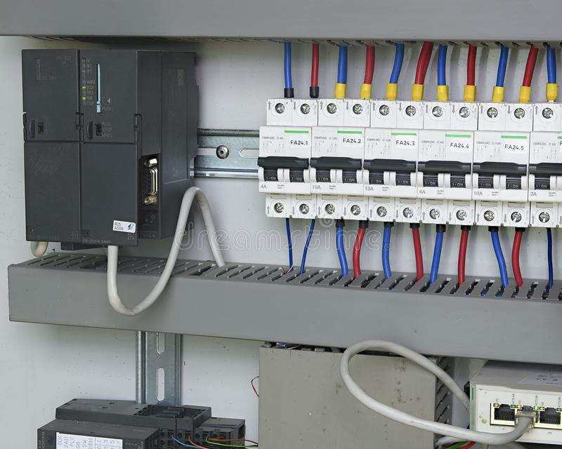 Image shows control cubicle. Electric device and circuit breakers inside power case.  stock photography