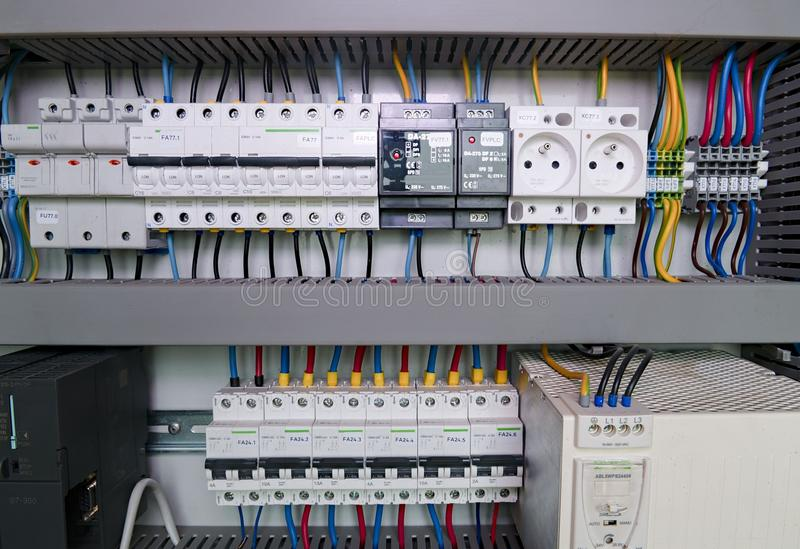 Image shows control cubicle. Electric device and circuit breakers inside power case.  stock images