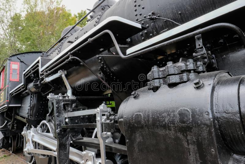 Detailed view of an old-style, American locomotive. royalty free stock photo