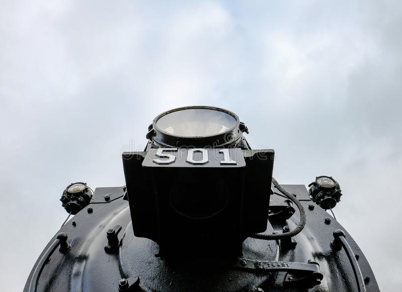 Detailed view of an old-style, American locomotive. royalty free stock photography