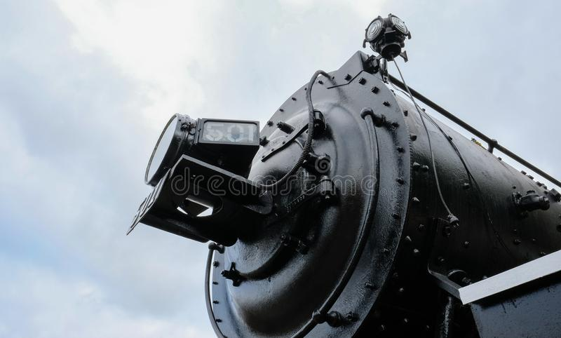 Detailed view of an old-style, American locomotive. royalty free stock images