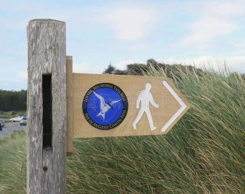 Signpost for the Anglesey Coastal Path. The image shows a fingerpost sign for the Anglesey Coastal path in North Wales. This is part of the All Wales coastal royalty free stock photography