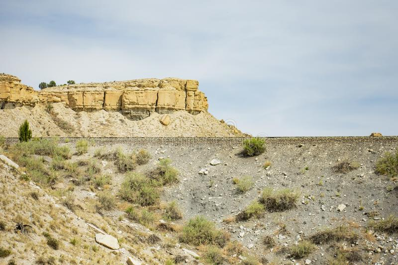 Train Tracks and Mesas. Image shows a set of Railroad tracks, cutting along the side of a Mesa, near Pueblo Colorado. Liked a few aspects of this picture, the stock images