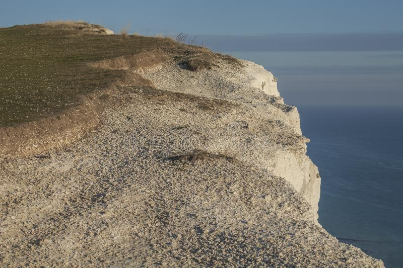 Seven Sisters, England, the UK - white cliffs, blue waters and seas. This image shows some white cliffs in Seven Sisters, England, the UK. It was taken on a stock photos