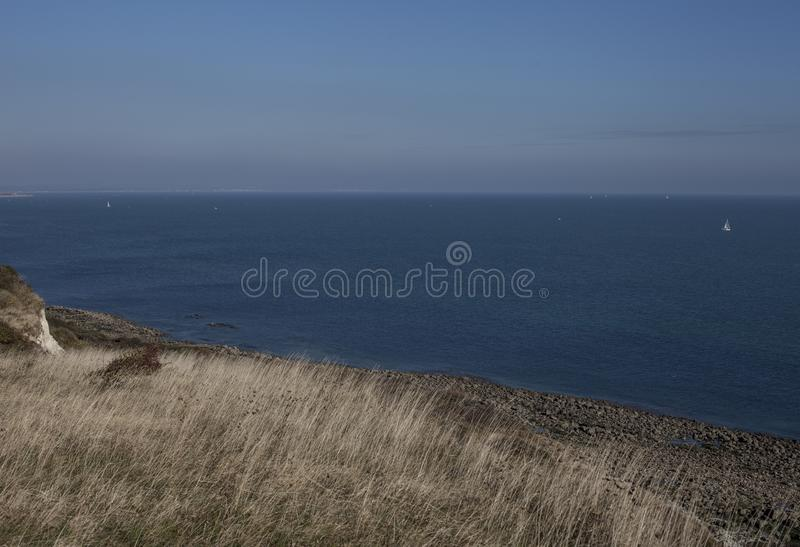 Eastbourne, England, the UK - meadows, skies, seas. This image shows a view of cliffs in Eastbourne, East Sussex, England, the UK. It was taken on a sunny day stock images