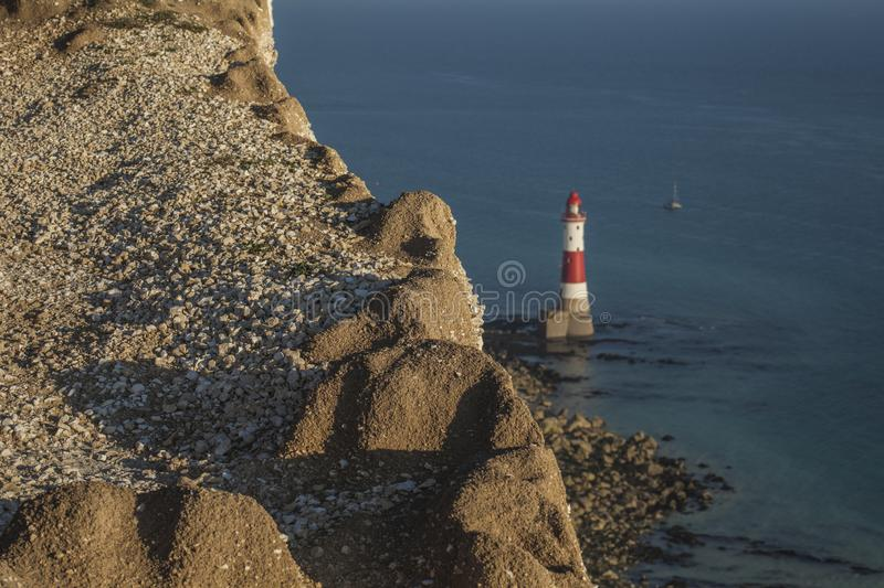 Beachy Head, East Sussex - cliffs, lighthouse, a blue sea. royalty free stock images
