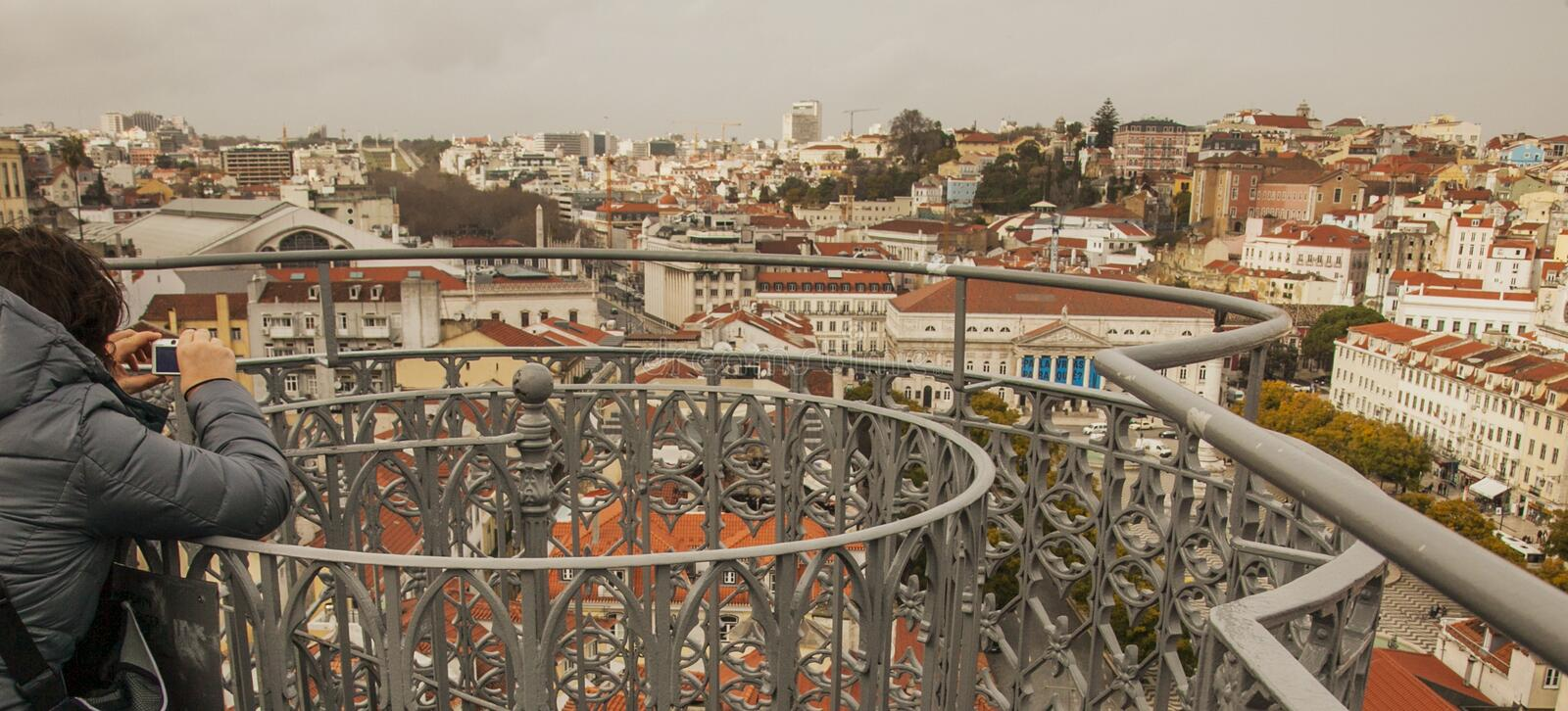 Lisbon, Portugal - at the top of the Santa Justa Lift. This image shows a view of Lisbon, Portugal. We can see a person taking pictures at the top of the Santa stock images