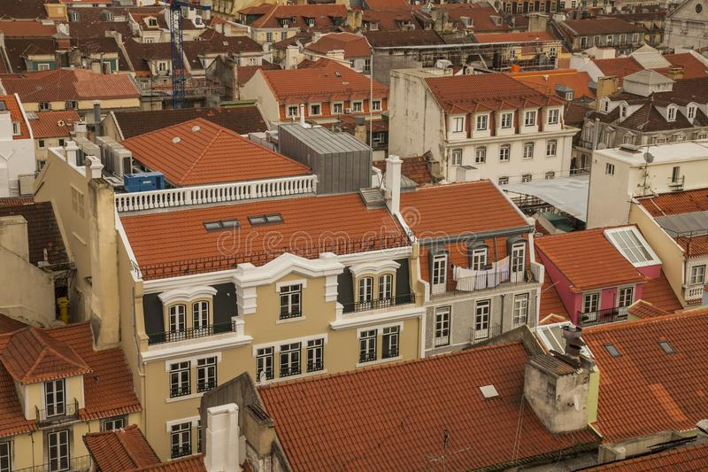 Lisbon - old town seen from the Santa Justa Lift. This image shows a view of Lisbon, Portugal, Europe. We can see the red roofs of the old town on a cloudy day stock photography
