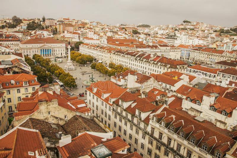 Lisbon - the houses of the old town seen from the Santa Justa Lift. This image shows a view of Lisbon, Portugal, Europe. We can see the red roofs of the old stock photography