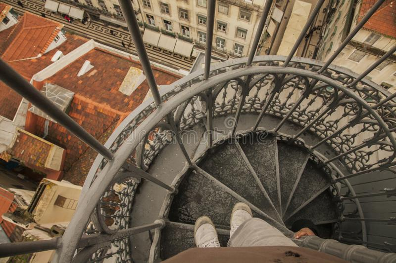 The Santa Justa lift - a staircase. This image shows a view of a staircase of the Santa Justa Lift. It was taken looking down in winter 2017 stock photos