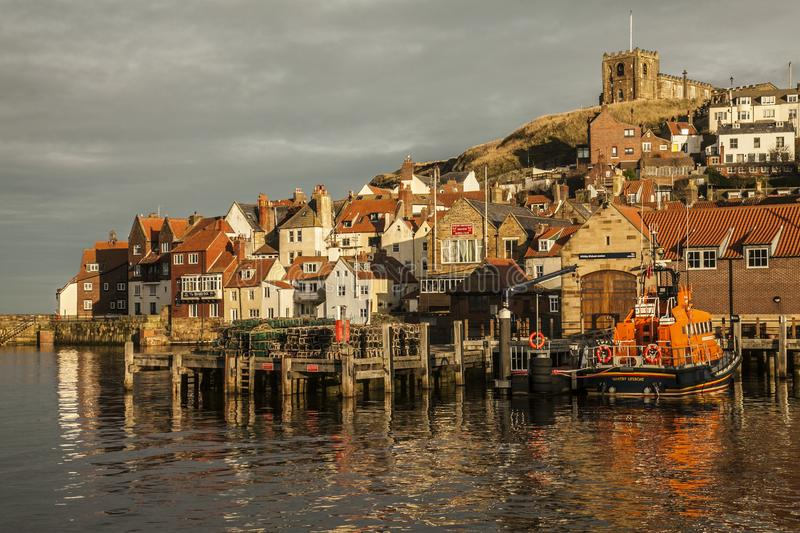 Whitby, Yorkshire, England - houses lit by sunshine. stock photo