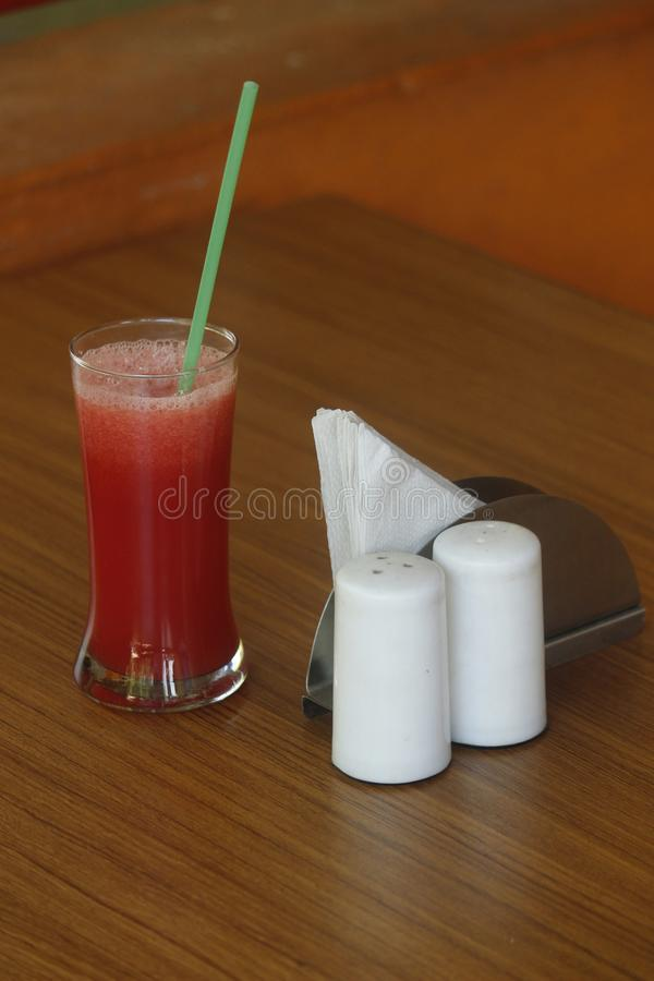 Watermelon juice in a glass with straw stock images