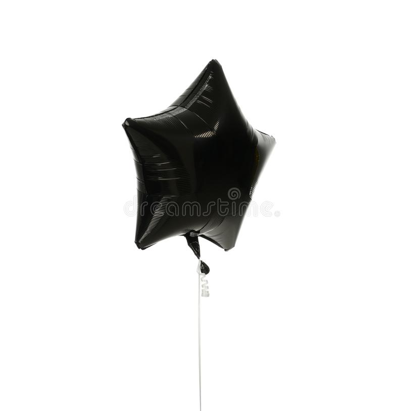 Image of single big black star latex balloon for birthday or wedding party stock image