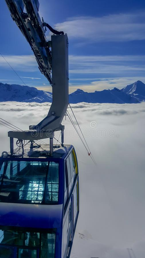 Image of ski gondola ropes who disappear in the fog. Image of ski gondola ropes who disappear in the mountain fog royalty free stock photography