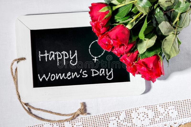 Image of a slate blackboard with chalk message Happy Women`s Day stock images