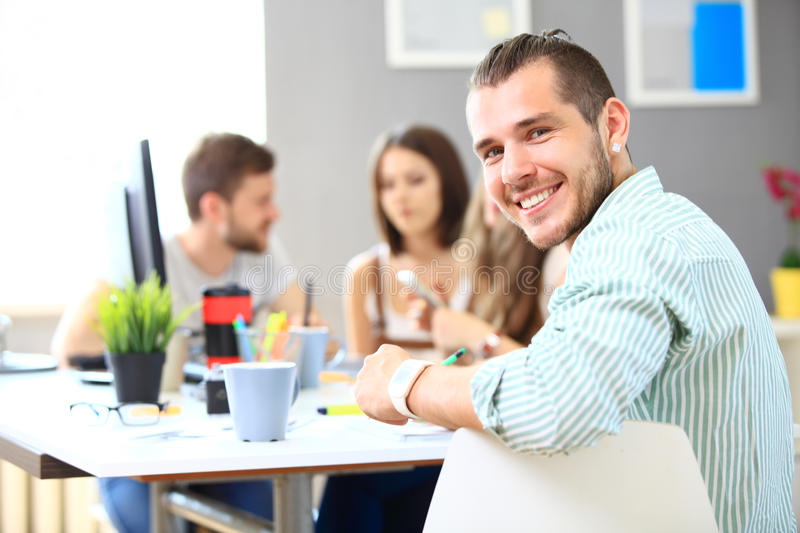 Image of smart young businessmen looking at camera. At meeting royalty free stock photos