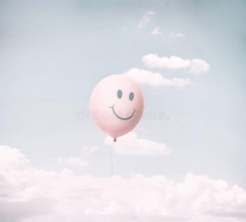 Image of a smiley balloon. Smiley balloon on a blue sky royalty free stock photos