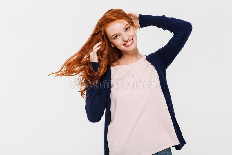 Smiling pretty young redhead lady stock photography