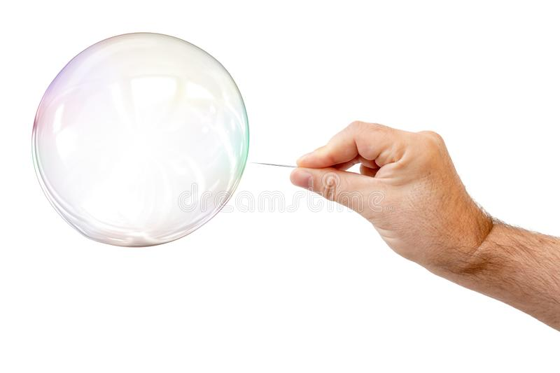 soap bubble and a males hand with needle to let it pop royalty free stock images