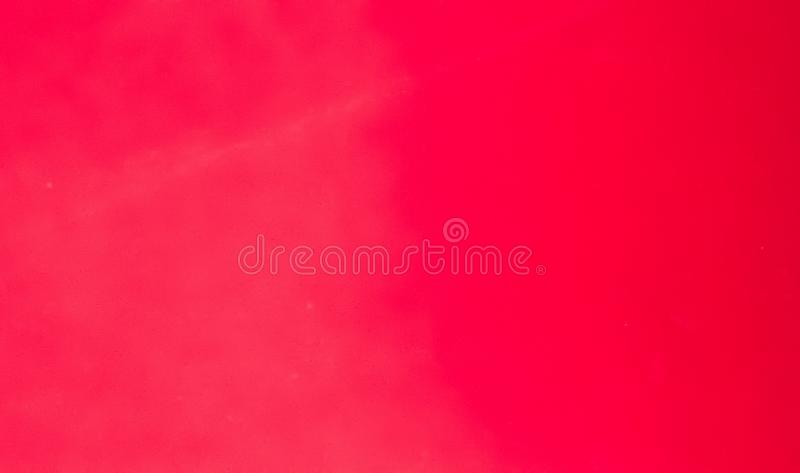 Image of a solid red background. In horizontal format stock photos