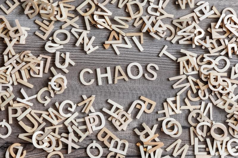some wooden letters and the word chaos stock photos