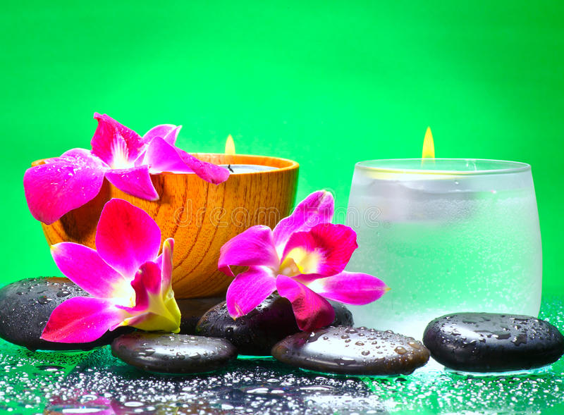 Image of spa therapy. Flowers in water and a bamboo mat stock image