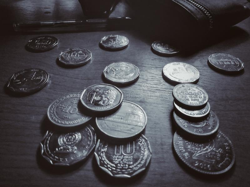 On the table difference coins . This is image are srilankan difference coins on the table stock photos