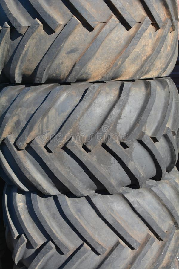 Stack of three heavy duty black tires in Salem, Oregon. This an image of a stack of three black tires in front at a tire store in Salem, Oregon stock photography