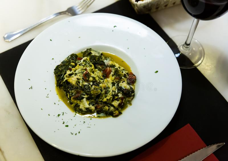 Image of stewed spinach with ham, dish of Catalan cuisine. Nobody stock images
