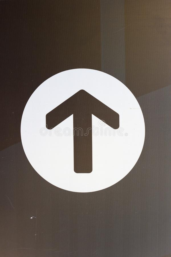 Image style is a White Arrow Down icon symbol inside a circle.  royalty free stock photo
