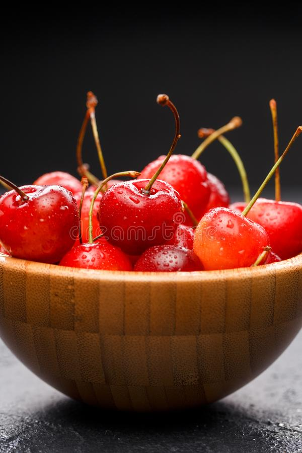 Image of sweet cherry in wooden cup royalty free stock photos