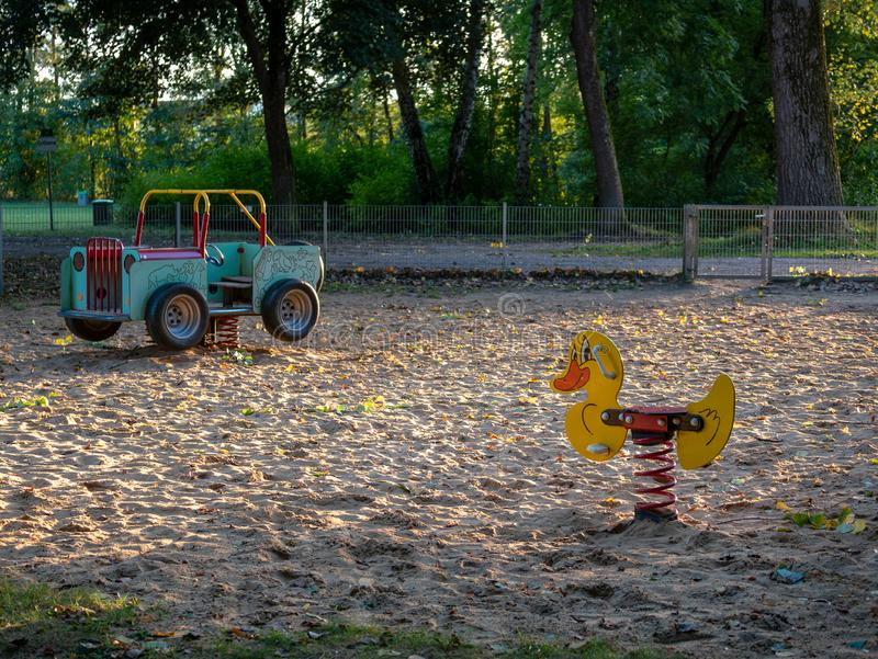 Image of swing duck and car at playground in sandpit royalty free stock images