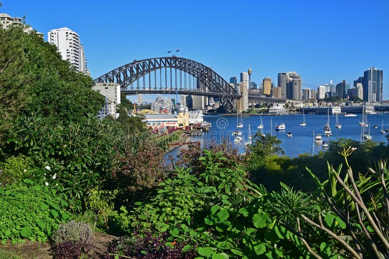 Taken from man made Wendy Secret Garden, view of Sydney Harbour Bridge and Luna Park Sydney. This image is taken from the hidden gem little park located at stock photo