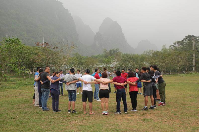 Moc Chau,Son La, Viet Nam - March 11, 2017: Staffs are happy and funny with team building activities of company. This image is taken at a park at Moc Chau, S stock photography