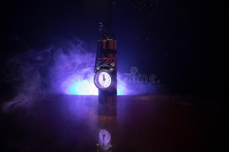 Image of a time bomb against dark background. Timer counting down to detonation illuminated in a shaft light shining through the. Darkness, conceptual image stock photos