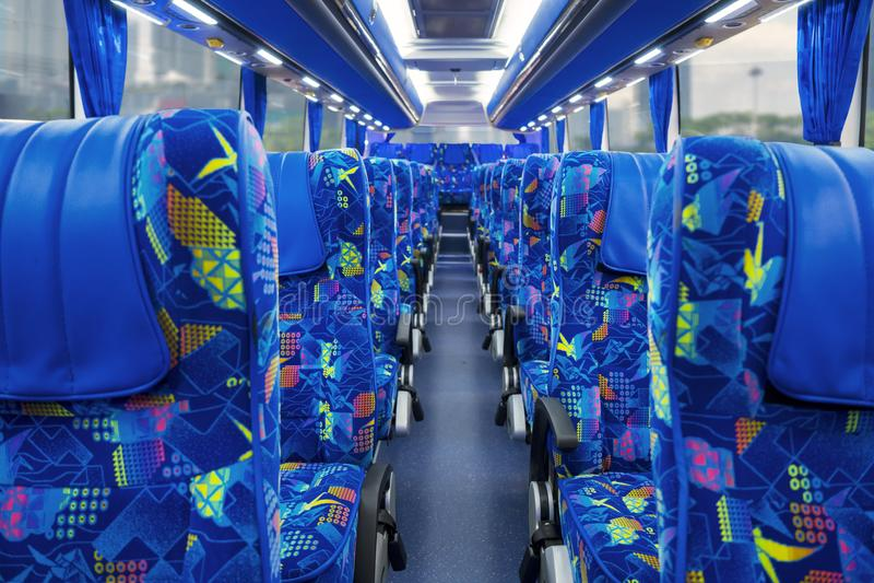 Travel bus interior with passenger seats. Image of travel bus interior with row of empty passenger seats stock photos