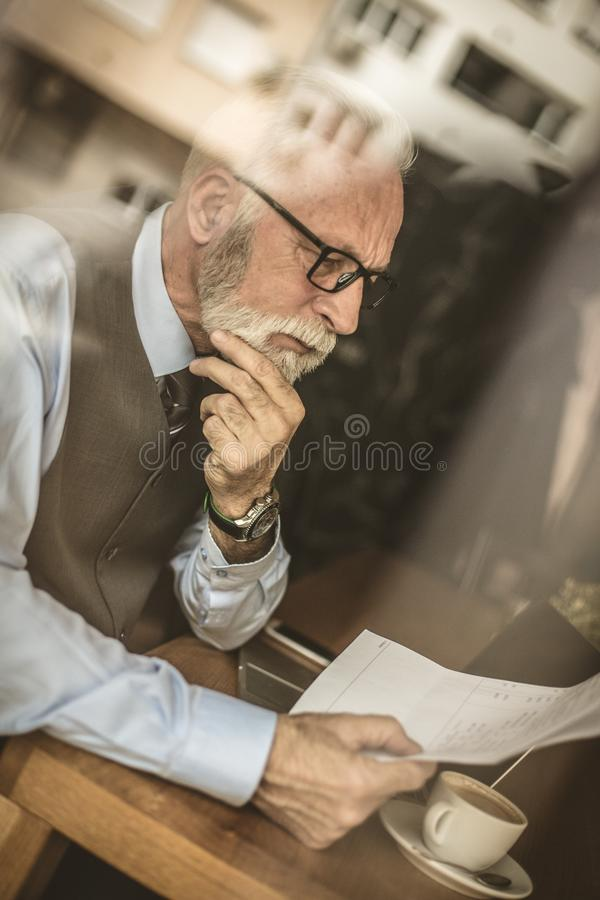 Image trough glass senior businessmen working. stock images