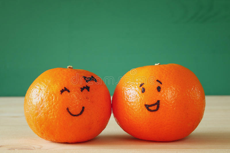 Download Image Of Two Clementines With Drawn Smiley Faces Stock Photo - Image: 83707286