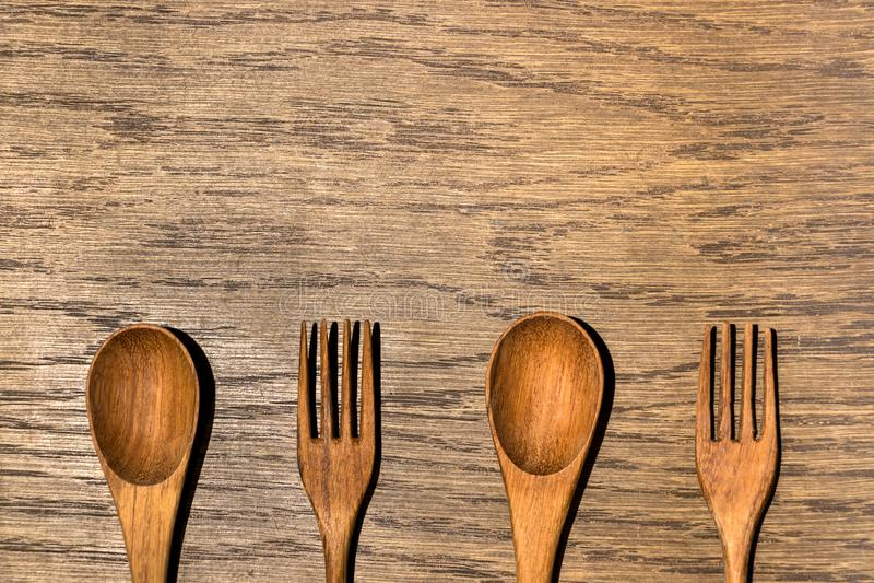 Wooden Kitchen Utensils in Wood Texture Background stock photos