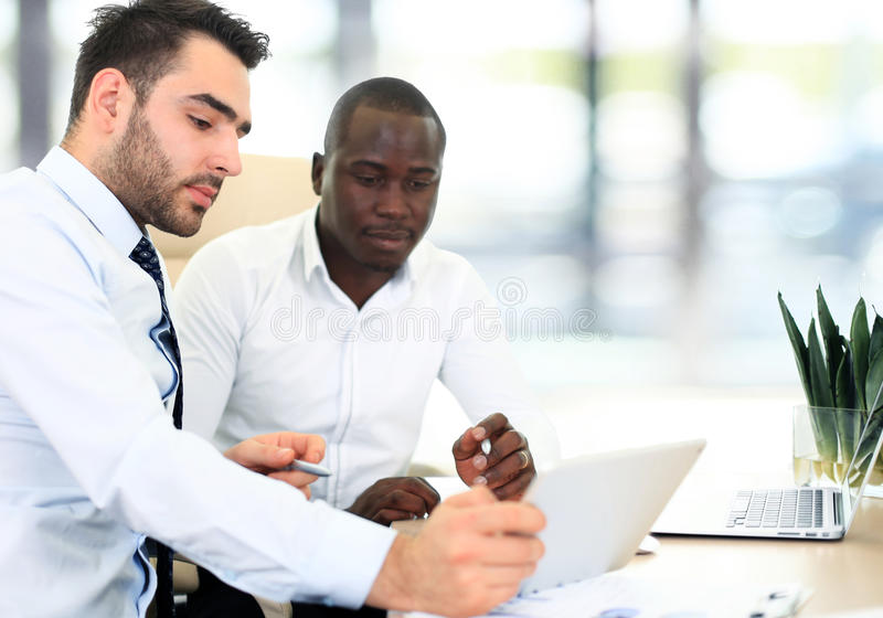 Image of two young businessmen. Interacting at meeting in office stock photos