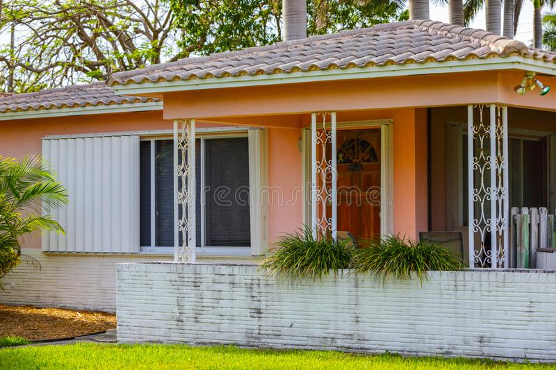 Image of a pink Florida House barrel roof tile and patio. Image of a typical old South Florida American home built in the 1950`s stock photography
