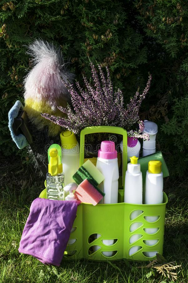 Various colorful tools for cleaning the premises and cleaning agents on a natural background. The concept of cleaning the premises royalty free stock photos