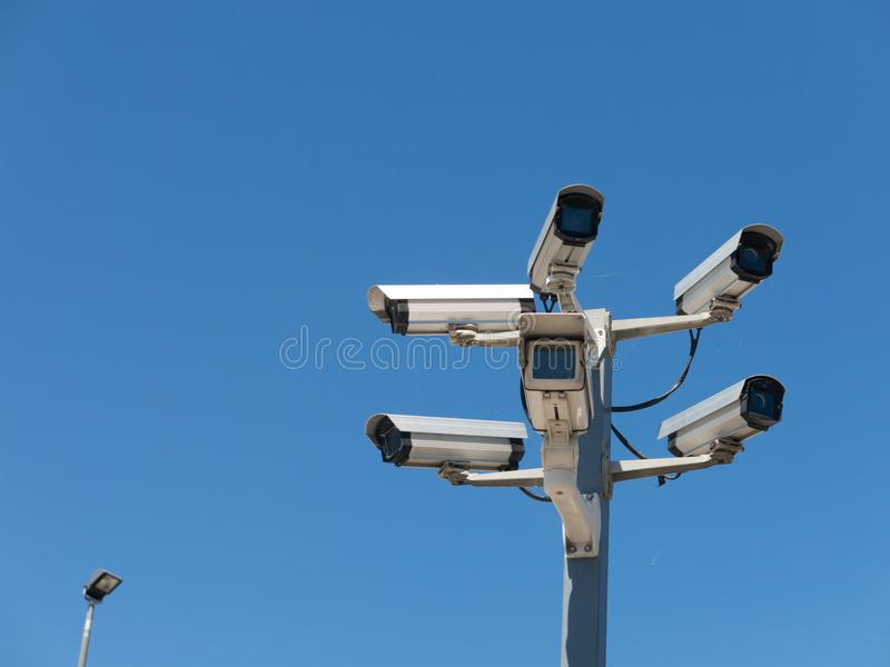 Image with various video surveillance cameras. Six cctv security cameras on the street pylon. Security cameras mounting on the high top position stock photography