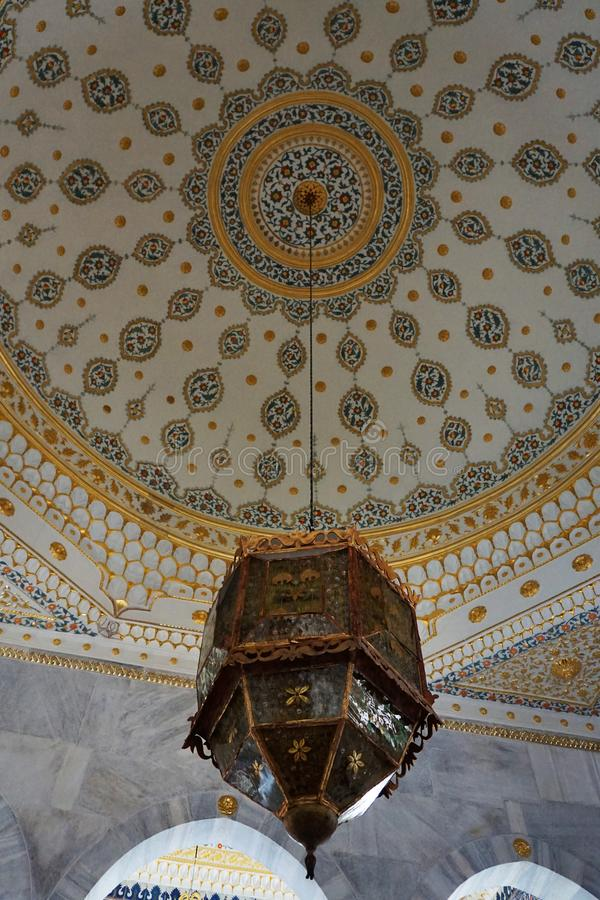 Istambul, Turkey - 31 august 2019: Vintage classical lamp hanging under a ceiling on Topkapi Palace in Istanbul, Turkey. royalty free stock photography