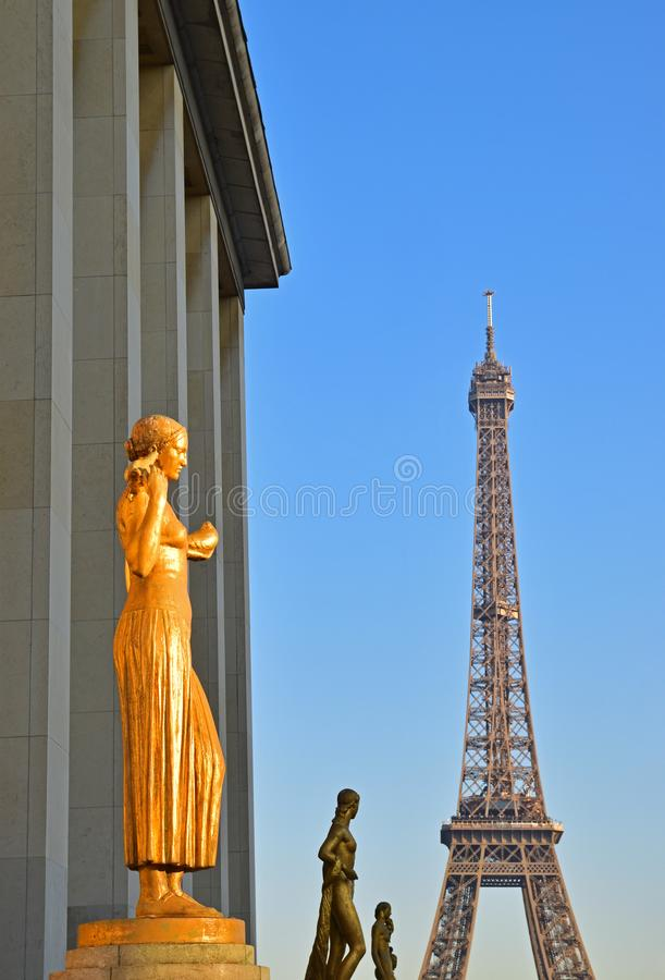 Golden and Bronze Statues in a row on Trocadero Square with Eiffel tower in the background. The image was taken in Paris near sunset with the first statue appear stock photos
