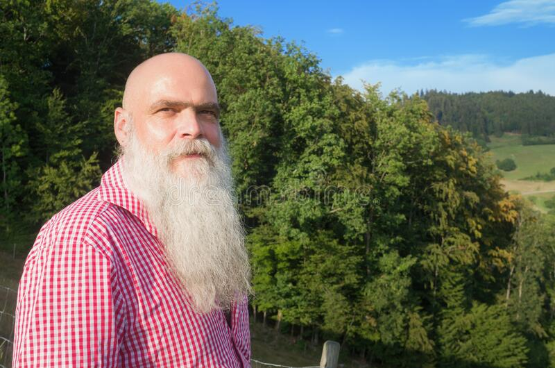 White bearded man in the forest stock photography