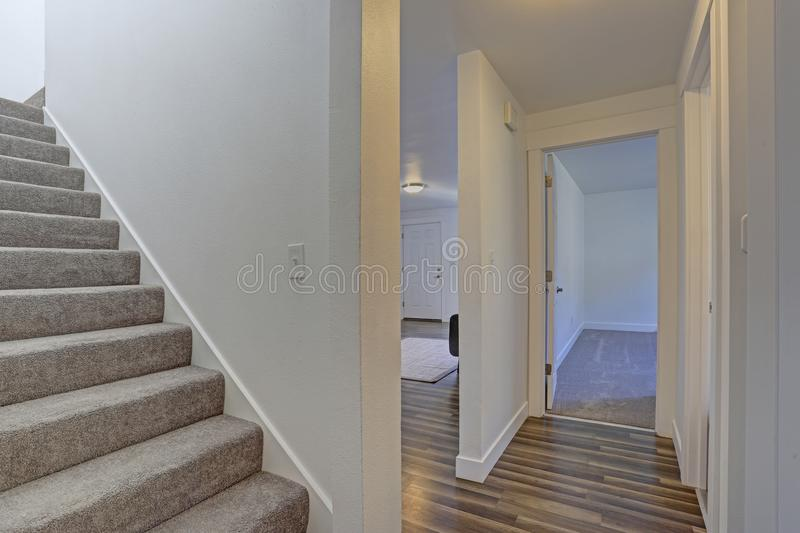 Image of a White hallway with a staircase royalty free stock photo